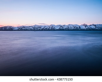 Beautiful Icelandic landscape at dawn. Mountains lit by rising sun
