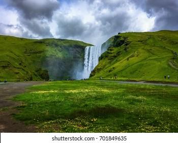 Beautiful Icelandic Landscape in Skogar. Skogafoss Waterfall on a Cloudy day.