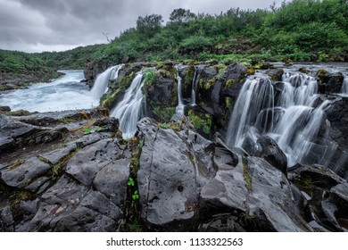 Beautiful Icelandic waterfall Hlaupatungufoss on a rainy day