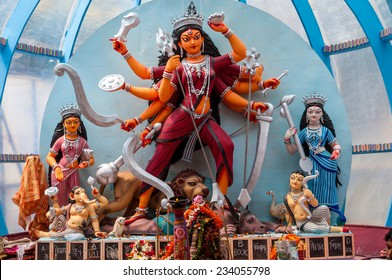 Beautiful idols of Hindu gods being worshipped during Durga Puja festival.