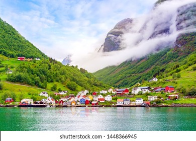 Beautiful idyllic landscape of the fjord Naeroyfjord in Gudvangen, Norway. A small traditional Scandinavian village on the picturesque coast of the fjord between the mountains. Travel background