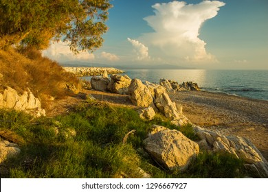 beautiful idyllic picturesque early autumn south European scenery landscape of park outdoor nature environment along sand rocky beach of Mediterranean sea