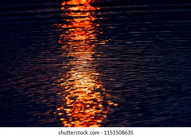 Beautiful illuminated blurry sunlight reflection in water unique natural photo