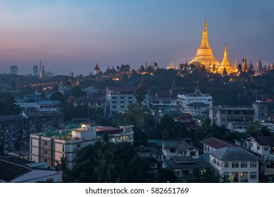 Beautiful illuminated golden Shwedagon pagoda (Shwedagon Zedi Daw) at dawn or twilight time, famous landmark and travel destination of Yangon, Myanmar (Burma)