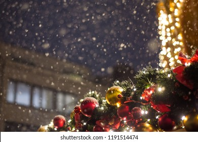Beautiful illumination at the Christmas market during a snowfall