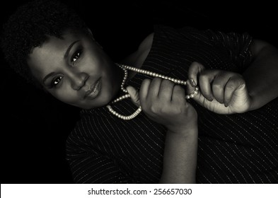 Beautiful Image of a afro American woman with pearls on Black