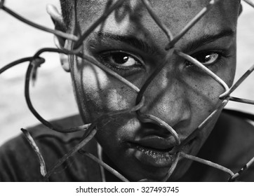 Beautiful Image of a afro American woman behind a fence, depicting Racism