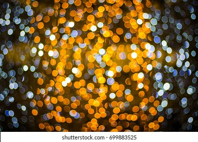 A beautiful image of a bokeh from New Year's garlands. In orange and blue colors