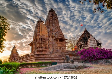 Beautiful image of Eastern Temples of Khajuraho, Madhyapradesh, India with blue sky and fluffy clouds in the background, It is worldwide famous ancient temples in India, UNESCO world heritage site.
