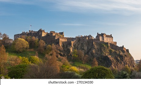 Beautiful image of Edinburgh Castle in Scotland. Photographed in May with blossoming park in foreground and during sunset 'golden hour', which is known for its perfect light