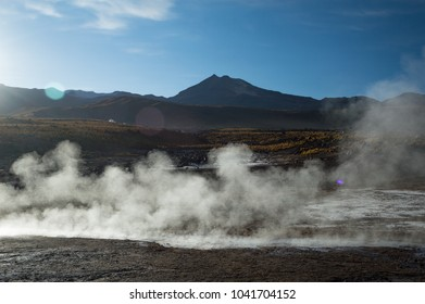 Beautiful image of geyser vapours in the sunlight at El Tatio geysers national park, Chile.