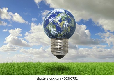 Beautiful image of a grass field with blue cloudy sky and a lightbulb planet