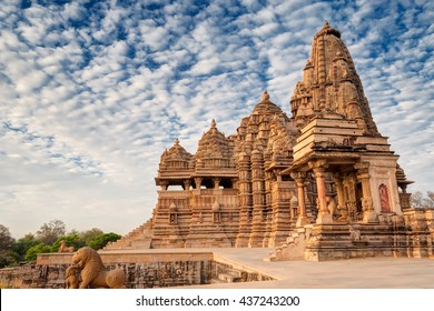 Beautiful image of Kandariya Mahadeva temple, Khajuraho, Madhyapradesh, India with blue sky and fluffy clouds in the background, worldwide famous ancient temples in India, UNESCO world heritage site.