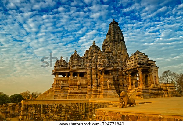 Beautiful image of Kandariya Mahadeva temple, Khajuraho, Madhyapradesh, India with blue sky and fluffy clouds in the background, world famous ancient temples in India, UNESCO world heritage site.