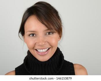 Beautiful image of a latino woman on grey