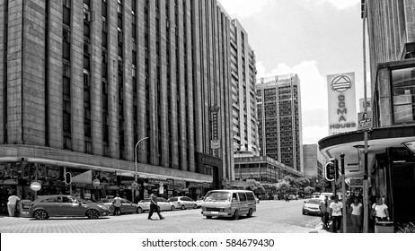 Beautiful image of modern Johannesburg. CBD. Black white photography. Urban landscape. People walk in the city. Streets of Joburg. African countries. Johannesburg, South Africa -December21,2013