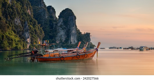 Beautiful image of sunset with colorful sky and Longtail boat on the sea tropical beach. Thailand