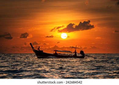 Beautiful image of sunset with colorful sky and Longtail boat on the sea. Thailand