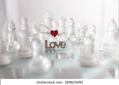 Beautiful image with table game game - chess reflecting a couple in love bound together in marriage. Greeting or invitation card in Valentine's day.