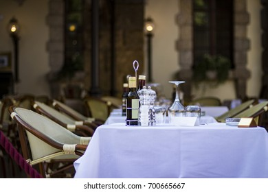 Beautiful image of tables in a street restaurant