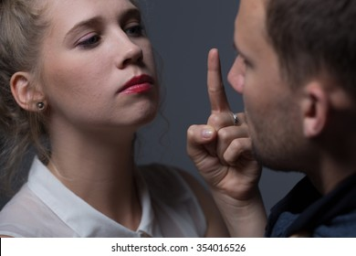 Beautiful imperative woman threatening to her husband