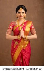 Beautiful Indian bridal greeting in studio shot.