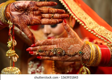 Beautiful Indian bride hands henna design hand jewelry kalira and red nail paint