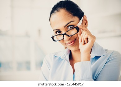 Beautiful Indian business woman portrait smiling happy