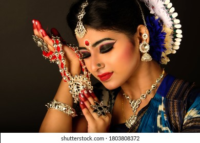 Beautiful Indian Classical Dancer Holding Traditional Dance Jewelry. Jewelry is an integral part of Indian Classical Dance. The dance is adoring the jewelry