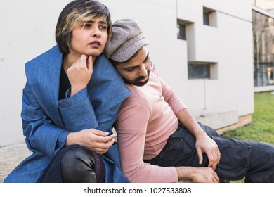 Beautiful Indian couple posing in an urban context. Street fashion and style.