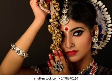 Beautiful Indian Dancer with 'Ghungroo'. The dancer put on blue lens to match with the costume.