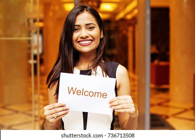 beautiful indian female hotel manager welcoming guests
