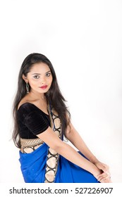 Beautiful Indian female in traditional dress on white background