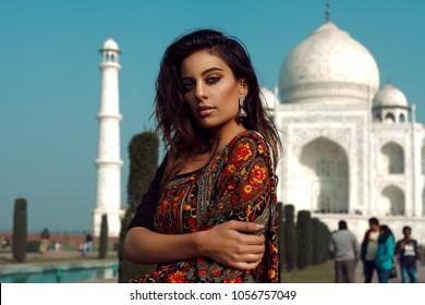 beautiful indian girl in front of taj mahal in india