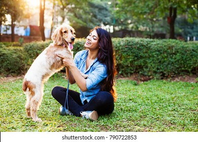 Beautiful indian girl with her cocker spaniel dog
