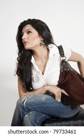 beautiful Indian girl holding handbag.
