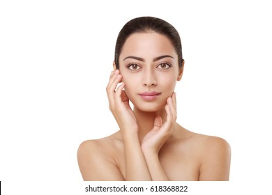 Beautiful indian girl with perfect skin make up closeup. Beauty and health care. Ideal closeup portrait of brunette touch her face, isolated on white background