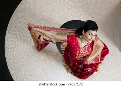 beautiful Indian girl wearing wedding gown or dress