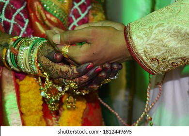Beautiful Indian Hindu Dulha and Dulhan hand.Indian Hindu wedding and Pre wedding ceremonial Rituals.