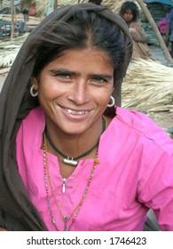 beautiful indian tribal women posing in a village in india