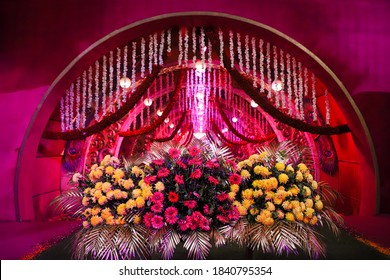The Beautiful  Indian wedding hall decoration with flowers and light.selective focous,background blur,selective focous on subject.