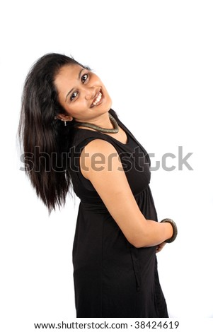 cede140c89 A beautiful Indian woman in black dress in a happy mood, on white studio  background