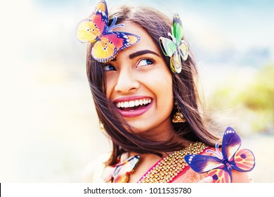 Beautiful indian woman with butterflies