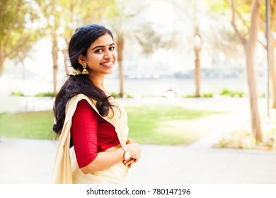 Beautiful indian woman from Kerala wearing traditional clothes