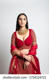 beautiful indian woman in a red bridal lehenga