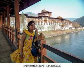 Beautiful Indian woman smiling to the camera in Punakha Dzong, Bhutan. Punakha Dzong is one of the oldest Dzongs, Bhutan, Asia