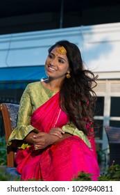 beautiful Indian woman smiling, wearing traditional dress
