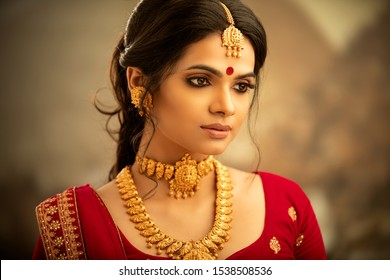 Beautiful Indian woman in traditional dress and jewelry.