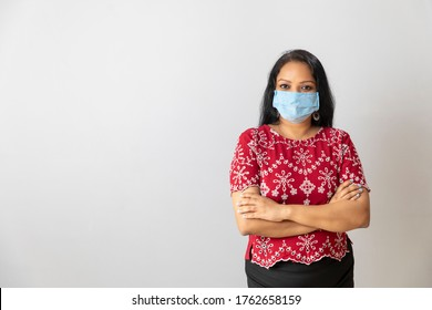 Beautiful Indian woman wearing a medical mask. Woman wearing a mask against air pollution and Covid-19
