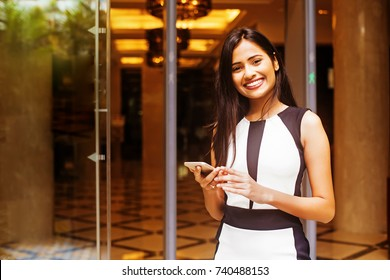 beautiful indian woman working as a hotel manager